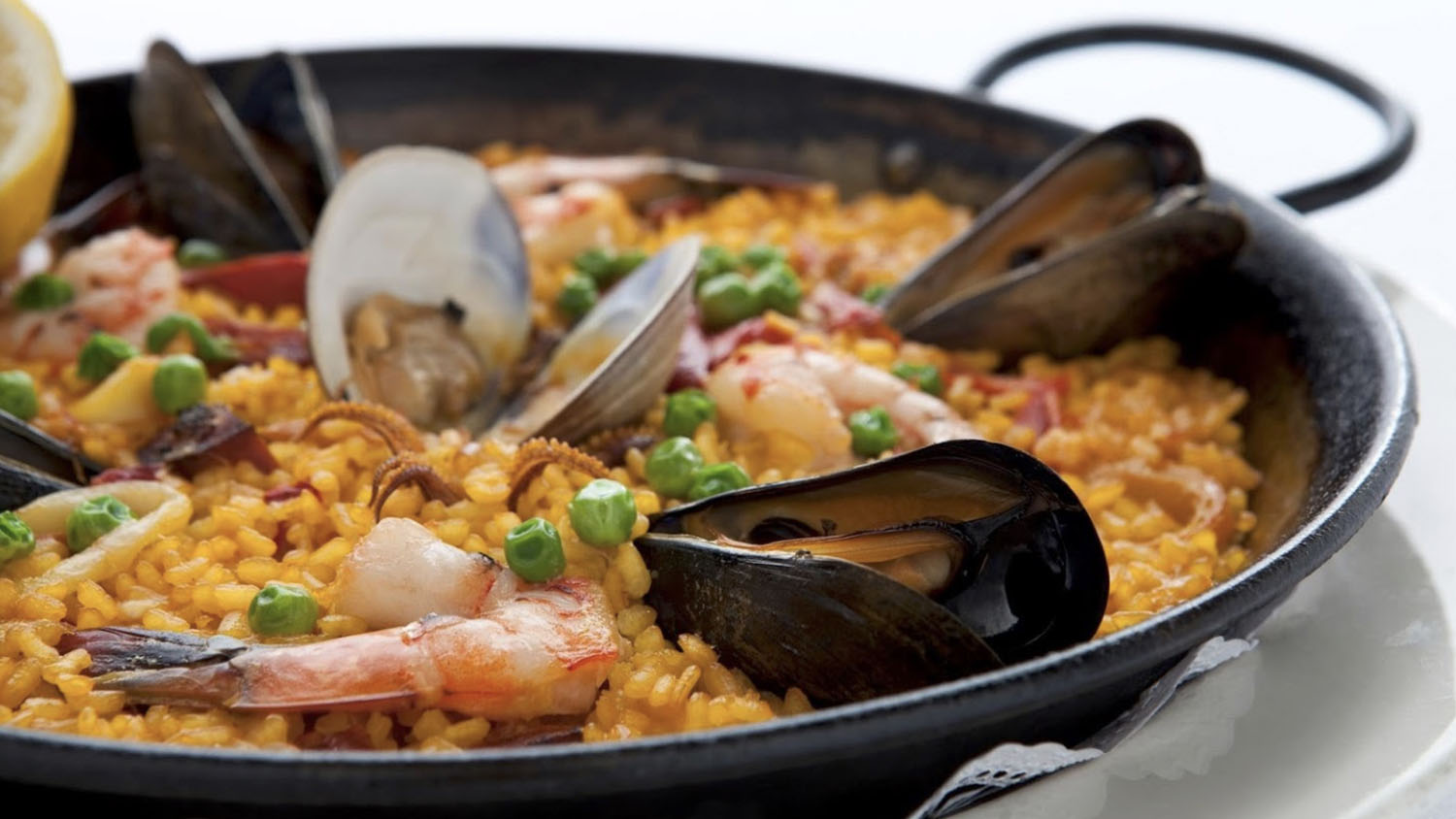 Learn How to Cook an Authentic Paella at Barcelona Tapas